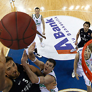Anadolu Efes's Semih Erden (L), Sasha Vujacic (R) and Zalgiris Kaunas's Darjus Lavrinovic (C) during their Turkish Airlines Euroleague Beskatball Top 16 Game 5 Anadolu Efes between Zalgiris Kaunas at Abdi Ipekci Arena in Istanbul Turkey on Friday 25 January 2013. Photo by Aykut AKICI/TURKPIX