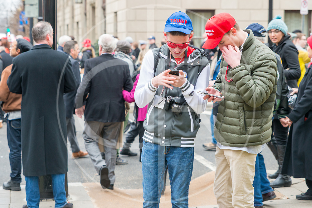 Washington DC, United States - Trump supporters check their mobile devices on the day of Donald J. Trump's inauguration.