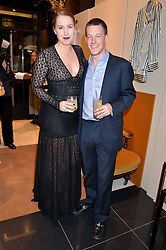OLIVIA VON HALLE and her husband HUGO VON HALLE at a party to celebrate the launch of Olivia von Halle, 151 Sloane Street, London on 25thNovember 2015