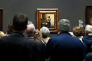 Visitors viewing painting by Johannes Vermeer 'The Milkmaid' at Rijksmuseum, Amsterdam, Holland