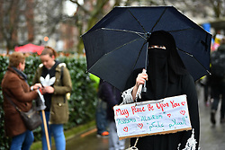 © Licensed to London News Pictures. 04/02/2017. London, UK. People gather in the rain before A demonstration against U.S President Donald Trump's Executive Order banning refugees and immigrants from a number of Muslim-majority countries. Protestors join campaign groups including Stop the War, Stand up to Racism, Muslim Association of Britain, in a march from the U.S Embassy in London to Downing Street. Photo credit: Ben Cawthra/LNP