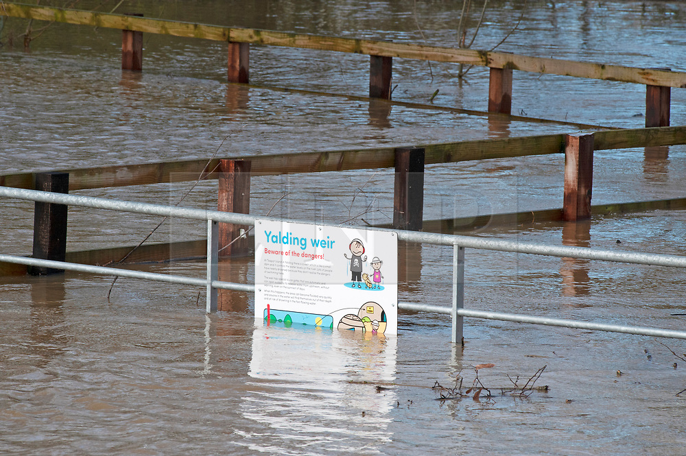 ©Licensed to London News Pictures 21/12/2019. <br /> Yalding ,UK. Yalding weir sign. Flood water 3ft high in parts on the Lees Road, Yalding.  The River Medway in Yalding, Kent has bursts its banks causing severe flooding to the village.   Photo credit: Grant Falvey/LNP