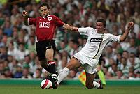 Photo: Paul Thomas.<br /> Glasgow Celtic v Manchester United. Pre Season Friendly. 26/07/2006.<br /> <br /> Manchester's Giuseppe Rossi gets away from Adam Virgo.