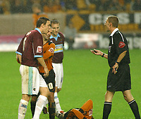 Photo: Dave Linney.<br />Wolverhampton Wanderers v Burnley. Coca Cola Championship. 30/09/2005. Michael Duff from Burnley is restrained by Colin Cameron before he is booked by Referee Steve Tanner