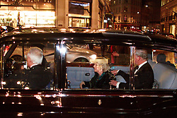 © under license to London News Pictures. 09/12/2010.  Camilla, Duchess of Cornwall, cowers in fear and is supported by husband Prince Charles as a mob surrounds the Royal Convoy in Regent Street after it is accidentally driven into the middle of a riot. A rioter physically attacks Camilla, Duchess of Cornwall, through an open window. The Rolls Royce carrying the couple is splattered with paint and a window is smashed. Photo credit should read Cliff Hide/LNP.