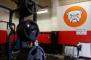 Signs inside the weight room serve as clear reminders of the dangers of the current Covid-19 pandemic to the members of the North Dallas Bulldogs football team on the first day of practice. <br />(Photo by Jaime R. Carrero)
