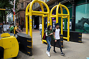 Yellow security barriers installed on New Street in Birmingham, United Kingdom. These temporary, movable barrier systems are placed strategically across the city in the wake of terrorist threats in places where large numbers of people gather as a preventative measure.
