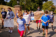 07 SEPTEMBER 2020 - DES MOINES, IOWA: High school athletes march around and picket the Iowa Governor's Mansion. About 300 Des Moines Public School (DMPS) high school athletes marched through Des Moines to the Governor's Mansion Monday to protest Gov. Kim Reynolds' recent efforts to reopen schools. DMPS, the largest school district in Iowa, is suing to go to online instruction because of the COVID-19 pandemic. The Governor is trying to force the district to reopen with in person instruction. The state ruled that schools using online education can't participate in extracurricular activities, including sports. The student athletes, who all wore face masks to comply with CDC guidelines, were marching to demand the ability to participate in sports despite using online instruction.       PHOTO BY JACK KURTZ