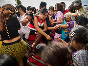 28 OCTOBER 2015 - KYAUKTAN, MYANMAR:  People climb onto a ferry to take them to Kyaik Hmaw Wun Pagoda, a pagoda on an island about two hours from Yangon during the  Thadingyut festival. The Thadingyut Festival, the Lighting Festival of Myanmar, is held on the full moon day of the Burmese Lunar month of Thadingyut. As a custom, it is held at the end of the Buddhist lent (Vassa). The Thadingyut festival is the celebration to welcome the Buddha's descent from heaven.   PHOTO BY JACK KURTZ