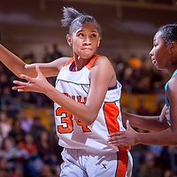 120613       Cable Hoover<br /> <br /> Gallup Bengal Ni'asia McIntosh (10) drives past Cleveland Storm Jade Hill (24) during the semi-final round of the John Lomasney Girls Basketball Invitational Friday at Gallup High School.