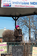Bar Harbor, Maine, USA. 19 January, 2019. Irene Choi addresses the crowd gathered on the Village Green for the Women's March Bar Harbor, a sister march of the national Women's March.