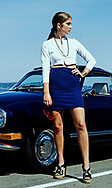 Taylor Benson wearing an outfit designed by Jessica Smith at Akli beach in fornt of a classic car.