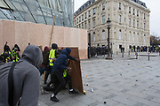 December, 8th, 2018 - Paris, Ile-de-France, France: Demonstrators making barricades on Champs Elysees. The French 'Gilets Jaunes' demonstrate a fourth day. Their movement was born against French President Macron's high fuel increases. They have been joined en mass by students and trade unionists unhappy with Macron's policies. Nigel Dickinson