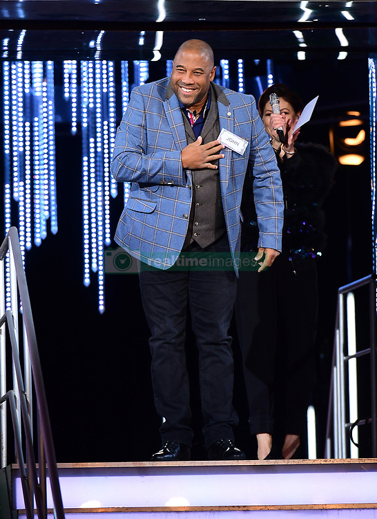 John Barnes enters the house during the Celebrity Big Brother Men's Launch held at Elstree Studios in Borehamwood, Hertfordshire.