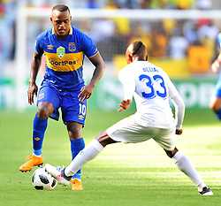 Cape Town--180401  Mamelodi Sundowns striker Khama Billiat  challenges by Ayanda Patosi  of Cape Town City during the Nedbank Cup quarter final game at the Cape Town Stadium.Sundowns won the game 2-1 and will play maritzburg in the Semi-final  .Photographer;Phando Jikelo/African News Agency/ANA
