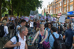 London, June 21st 2017. Protesters march through London from Sheherd's Bush Green in what the organisers call 'A Day Of Rage' in the wake of the Grenfell Tower fire disaster. The march is organised by the Movement for Justice By Any Means Necessary and coincides with the Queen's Speech at Parliament, the destination. PICTURED: The march sets off from Shepherd's Bush Green.