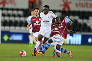 Bafetimbi Gomis of Swansea city is tackled by Idrissa Gana Gueye of Aston Villa. Barclays Premier league match, Swansea city v Aston Villa at the Liberty Stadium in Swansea, South Wales on Saturday 19th March 2016.<br /> pic by  Andrew Orchard, Andrew Orchard sports photography.
