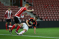 Manchester United U21 Josh Harrop tackles Southampton Harry Reed during the Barclays U21 Premier League match between U21 Southampton and U21 Manchester United at the St Mary's Stadium, Southampton, England on 25 April 2016. Photo by Phil Duncan.