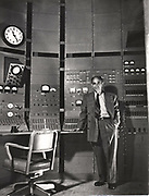 Enrico Fermi (1901-54) Italian-born American nuclear physicist. Nobel prize for physics 1938, shown here at control of Chicago synchro-cyclotron c1942.