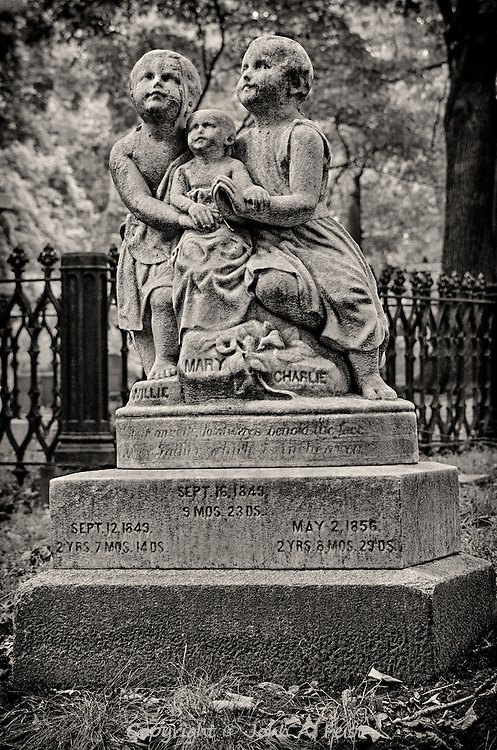 Mount Auburn Cemetery in Watertown, MA dates back to before the Civil War.  While touring this beautiful park, I saw this marker.  It is sad in that it commemorates the deaths of three children.  I was taken by the beauty of the stone, the details that have survived for over 150 years and the message of hope and faith it projects.