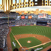 A panoramic view of Yankee Stadium as the late evening sunshine catches the Yankee Stadium facade during the New York Yankees V Baltimore Orioles American League Division Series play-off decider at Yankee Stadium, The Bronx, New York. 12th October 2012. Photo Tim Clayton Note to Editors. This image is a composite of three images taken a split second apart and merged in editing.