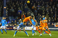 Luton Town defender James Justin (2) in the air with Bradford City forward Kai Brunker (18)  during the EFL Sky Bet League 1 match between Luton Town and Bradford City at Kenilworth Road, Luton, England on 27 November 2018.