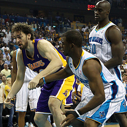 April 24, 2011; New Orleans, LA, USA; New Orleans Hornets point guard Chris Paul (3) knocks the ball away from Los Angeles Lakers power forward Pau Gasol (16) during the first quarter in game four of the first round of the 2011 NBA playoffs at the New Orleans Arena.    Mandatory Credit: Derick E. Hingle