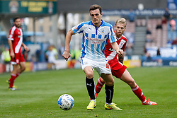 Jack Robinson of Huddersfield is challenged by Adam Clayton of Middlesbrough - Photo mandatory by-line: Rogan Thomson/JMP - 07966 386802 - 13/09/2014 - SPORT - FOOTBALL - Huddersfield, England - The John Smith's Stadium - Huddersfield town v Middlesbrough - Sky Bet Championship.