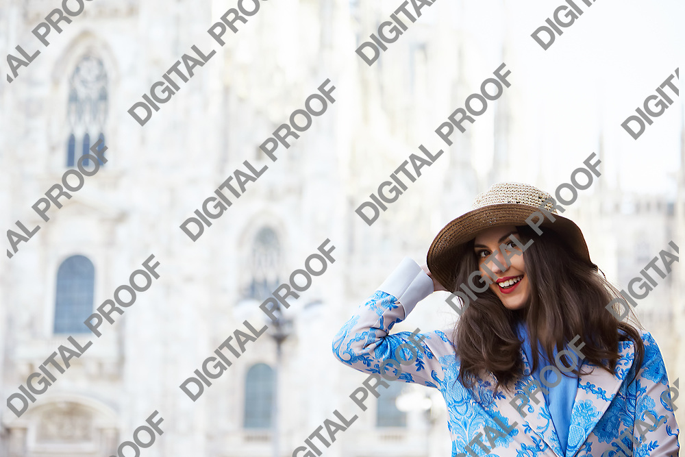 Portrait of a female model in front of the Duomo of Milan italy during the day