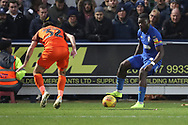 AFC Wimbledon defender Deji Oshilaja (4) taking on Southend United defender Stephen Hendrie (32) during the EFL Sky Bet League 1 match between AFC Wimbledon and Southend United at the Cherry Red Records Stadium, Kingston, England on 24 November 2018.