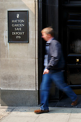 © Licensed to London News Pictures. 08/04/2015. LONDON, UK. A Hatton Garden burglary victim leaving Hatton Garden Safety Deposit Ltd after finding out whether he lost any items or not as detectives and scenes of crime officers carrying out a forensic examination at Hatton Garden Safety Deposit Ltd in London on Wednesday, 8 April 2015. Police believes that approximately 60 - 70 safety deposit boxes were opened during the burglary over Easter weekend. Photo credit : Tolga Akmen/LNP