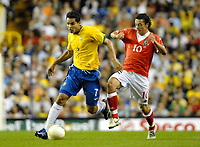 Photo: Ed Godden.<br /> Brazil v Wales. International Friendly. 05/09/2006.<br /> Alexandro Souza (L) is followed by Wales's Simon Davies.