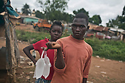 A boy sells water in plastic bags in Bangui, Central African Republic.