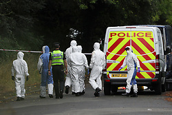 © Licensed to London News Pictures. 16/08/2020. Calne, UK. Members of an investigation team at the scene on the A4 at Derry Hill near Calne in Wiltshire where four people have been killed in a road traffic accident in which a car is believed to have hit a house then caught fire.  Photo credit: Tim Ireland/LNP