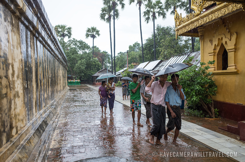 """Visitors brave a downpour at the Myazedi (or Mya Zedi) Pagoda, in the northern part of Myinkaba Village, just woth of Old Bagan. Myazedi translates as """"emerald stupa."""""""