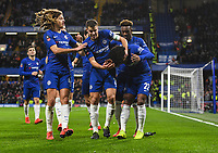 Football - 2018 / 2019 Emirates FA Cup - Fourth Round: Chelsea vs. Sheffield Wednesday<br /> <br /> Chelsea's Willian celebrates scoring the opening goal from the penalty spot after Cesar Azpilicueta was fouled by Sheffield Wednesday's Sam Hutchinson as coins are thrown from the away end, at Stamford Bridge.<br /> <br /> COLORSPORT/ASHLEY WESTERN