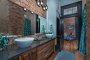 Brick, wood, and texture in this architecturally beautiful 19th century bathroom in Nashville by Rodney Bedsole Photography