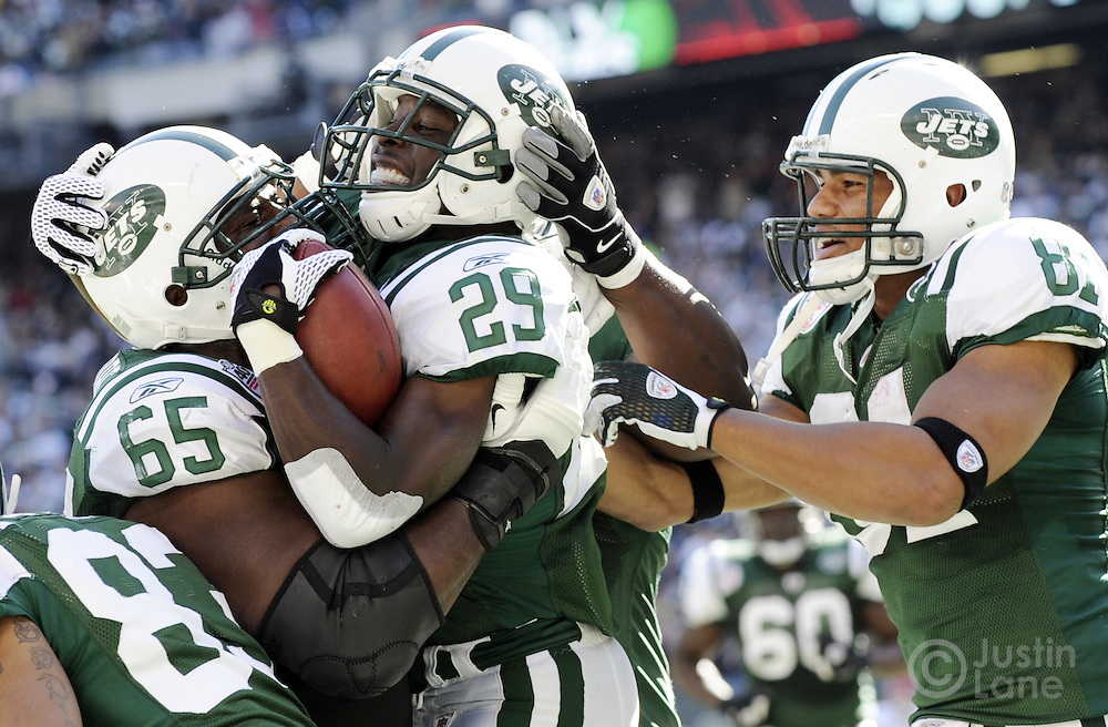 The Jets' Leon Washington (C) celebrates scoring a touchdown with teammates Brandon Moore (L) and Dustin Keller (R) during the second quarter of the game between the Kansas City Chiefs and the New York Jets at Giants Stadium in East Rutherford, New Jersey on 26 October 2008.