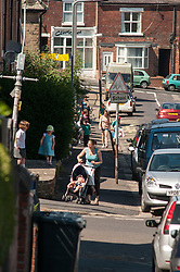 Childminder collecting children from school