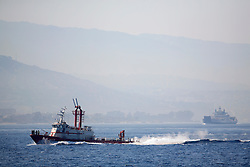 ITALY SICILY 30APR08 - Italian firefighting vessel sails through the Strait of Messina, a narrow gap between the southern Tip of Italy and Sicily seen from aboard the Greenpeace ship Arctic Sunrise in the Mediterranean...jre/Photo by Jiri Rezac..© Jiri Rezac 2008..Contact: +44 (0) 7050 110 417.Mobile:  +44 (0) 7801 337 683.Office:  +44 (0) 20 8968 9635..Email:   jiri@jirirezac.com.Web:    www.jirirezac.com..© All images Jiri Rezac 2007 - All rights reserved.