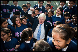 London Mayor Boris Johnson is mobbed by school children in Delhi today after he handed over the London 2012 Olympic cauldron petals to Indian Olympians. The petals which were part of the Thomas Heatherwick designed cauldron which burnt throughout the Olympic and Paralympic Games will be given to every competing nation, on the second day of a six-day tour of India, where he will be trying to persuade Indian businesses to invest in London, Monday November 26, 2012. Photo by Andrew Parsons / i-Images