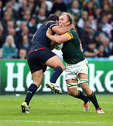 Schalk Burger of South Africa is stopped with a neck high tackle by Chris Baumann of USA<br /> Rugby World Cup England 2015 - South Africa v USA - 07/10/2015 - Queen Elizabeth Olympic Stadium - London<br /> Mandatory Credit : Andrew Fosker / Seconds Left <br /> {22062000}