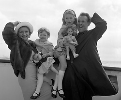 File photo dated 29/3/1962 of Bruce Forsyth with his wife, Penny, and their two daughters, Debbie (right), 6, and Julie, 3, who will celebrate her fourth birthday at sea, as they left Southampton aboard the liner Pendennis Castle for South Africa. The veteran entertainer has died aged 89