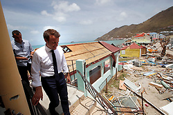 France's President Emmanuel Macron walks down a destroyed building during his visit in the French Caribbean islands of St. Martin , Tuesday, Sept. 12, 2017. Macron is in the French-Dutch island of St. Martin, where 10 people were killed on the French side and four on the Dutch. Photo by Christophe Ena/Pool/ABACAPRESS.COM