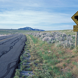 Syracuse, UT. The park road and a bison sign at Antelope Island State Park on Utah's Great Salt Lake.