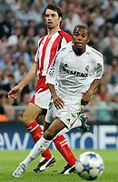 Real Madrid's Robinho in duel with Olympiakos' Kostoulas during their Champions League match at Santiago Bernabeu Stadium in Madrid, Wednesday 28 September, 2005. (Photo / Alvaro Hernandez)