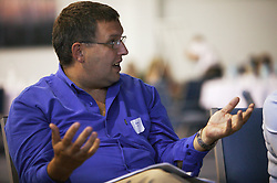 An employee talking at an NHS Training event on staff development,