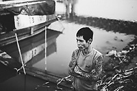 A portrait of Anh Tuan near his home on the banks of the Red River in Hanoi, Vietnam. Tuan recently spent time in jail and is having a hard time getting his life back in order, as many businesses are weary of hiring an ex-convict.