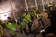 Police line. Thousands of protesters, some masked meet in Trafalgar square and march around central London marking 5th November guy fawkes night, some inceidents were reported and scuffles with the Police in Parliament square, Buckingham palace, Regent Street, Picadilly and Oxford street, London, UK.