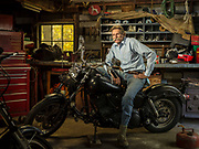 David Brill sits atop one of four Harley Davidson motorcyles he owns, in his garage in Fayetteville, Georgia.  A real character in every sense of the word, David has created images for National Georgraphic, among others.